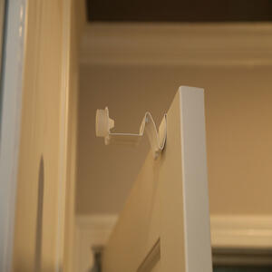 STOPPCLIPP  6 in. H x 3 in. W x 3 in. L Steel  White  Door Stop  Mounts to door
