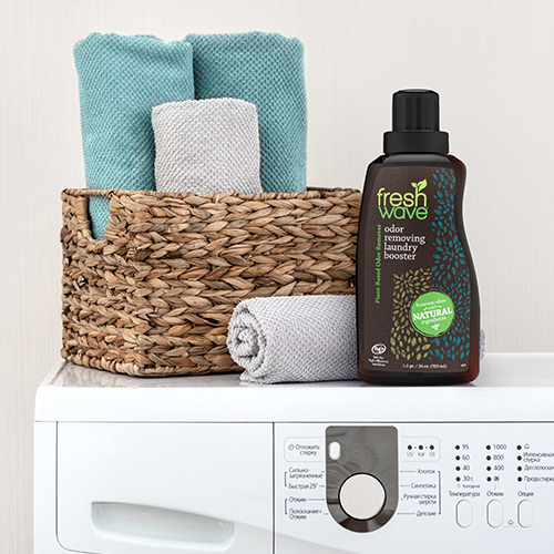 Fresh Wave Odor Removing Laundry Booster Sitting on Top of Washing Machine