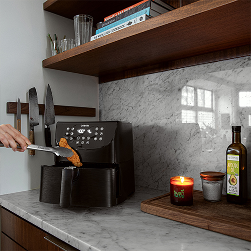 Fresh Wave Odor Removing Candle Sitting on a Kitchen Counter Top