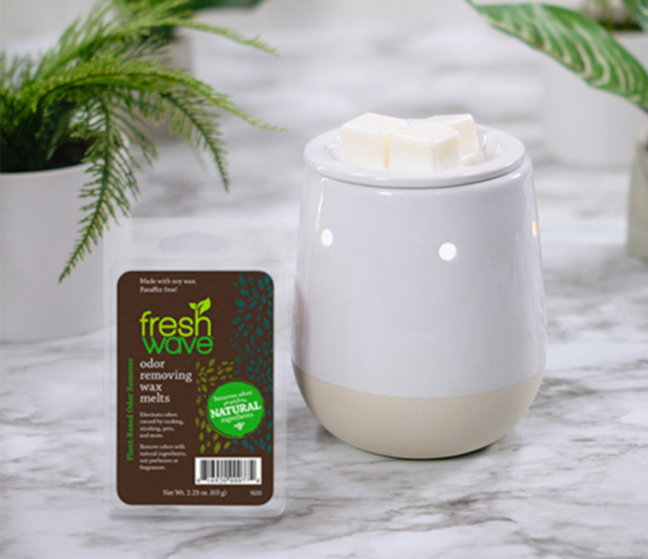 Fresh Wave Odor Removing Wax Melts Sitting Next to a Hot Wax Burner with Fresh Wave Wax Melts Burning on Top
